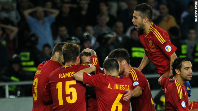 Spain celebrate with Roberto Soldado after the striker silences a packed stadium in Tbilisi with his late winner