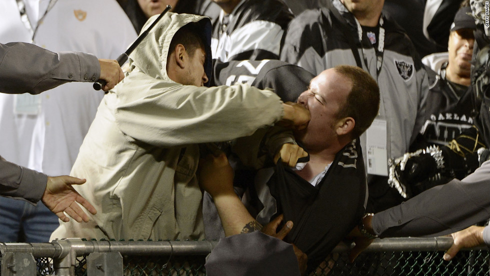 Two fans fight during the season opener of an NFL football game between the San Diego Chargers and Oakland Raiders at Oakland-Alameda County Coliseum on Monday, September 10, in Oakland, California. The Chargers won the game 22-14.