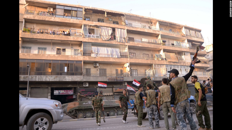 Syrian government forces take position in a residential neighbourhood in Aleppo on Saturday, September 8.