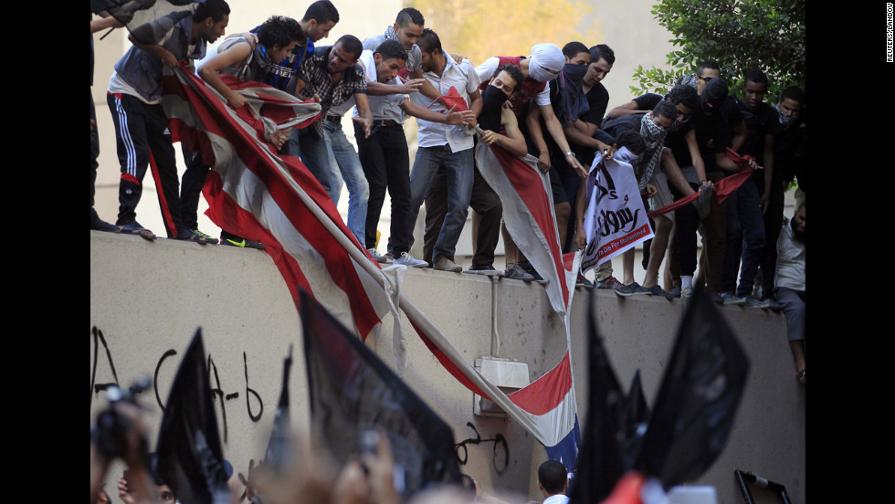 Protesters destroy an American flag pulled down from the U.S. Embassy in Cairo, Egypt.