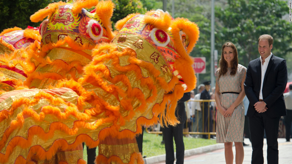Prince William, right, and wife Catherine are welcomed by a lion dance performance on Wednesday.