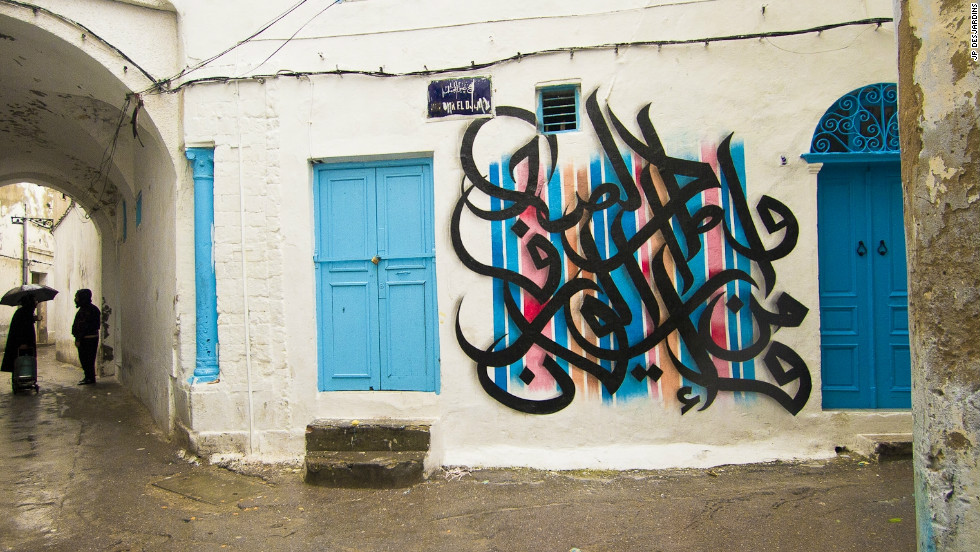 "Calligraffiti on a wall in a neighborhood of Tunis. It spells a quote by Tunisian poet  Abu Al Qassim Acchabi: ""The sun rose behind the centuries."""