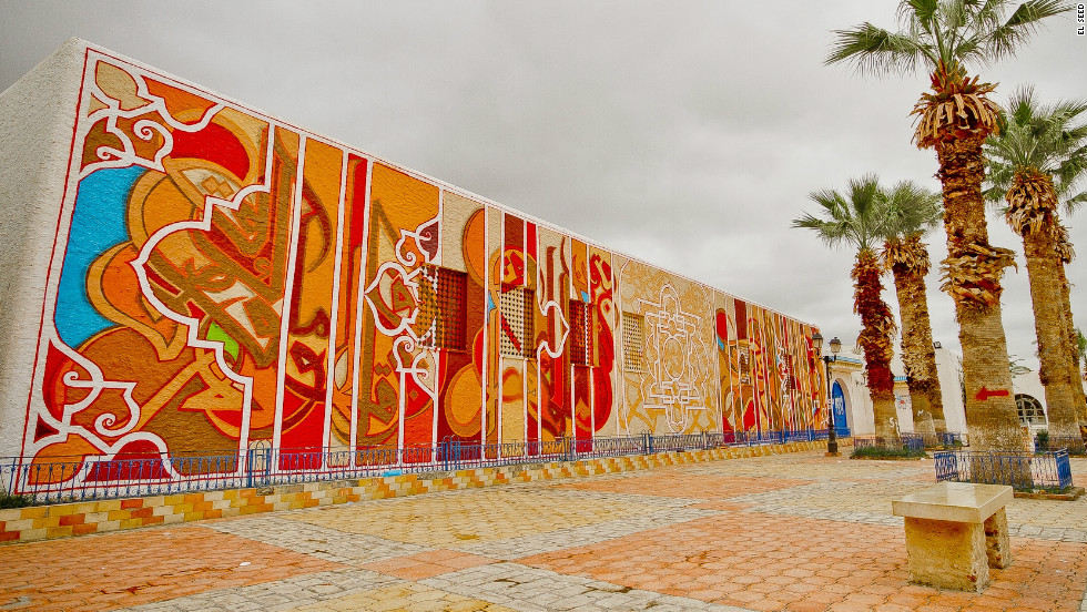 A giant mural in the town of Kairouan to celebrate the first anniversary of the Tunisian revolution. This was part of a project supported by the community organization Al Khaldounia.