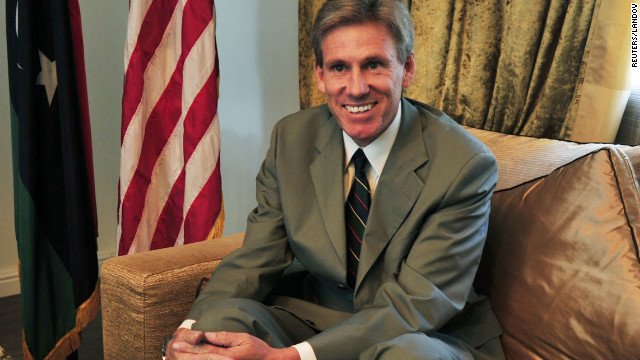 Image #: 19358881    Christopher Stevens, the U.S. ambassador to Libya, smiles at his home in Tripoli June 28, 2012. Stevens and three embassy staff were killed late on September 11, 2012, as they rushed away from a consulate building in Benghazi, stormed by al Qaeda-linked gunmen blaming America for a film that they said insulted the Prophet Mohammad. Stevens was trying to leave the consulate building for a safer location as part of an evacuation when gunmen launched an intense attack, apparently forcing security personnel to withdraw. Picture taken June 28, 2012. REUTERS/Esam Al-Fetori (LIBYA - Tags: POLITICS CIVIL UNREST OBITUARY)       REUTERS /ESAM OMRAN AL-FETORI /LANDOV