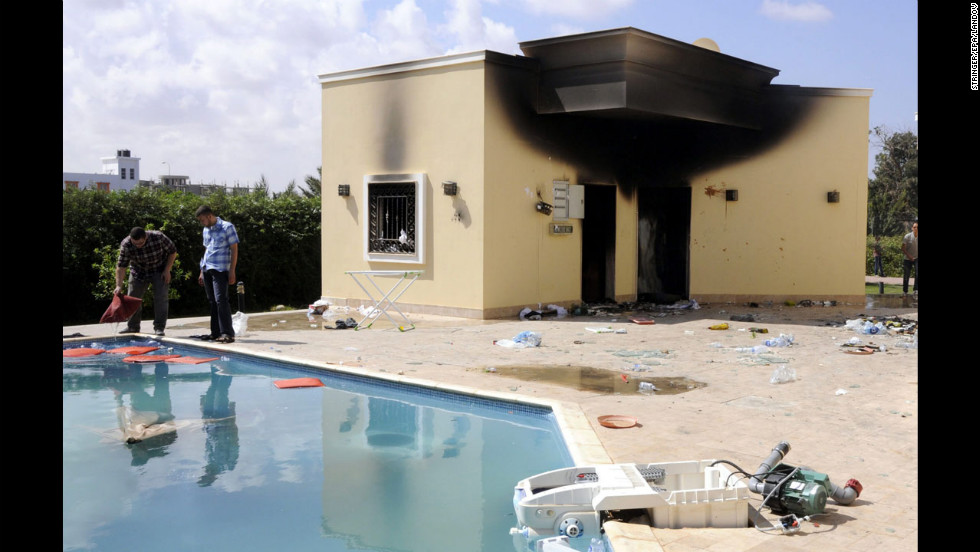People inspect the damage at the U.S. Consulate in Benghazi, Libya, on Wednesday, the day after four people were killed.