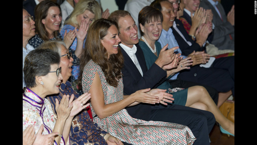 The duke and duchess applaud as they visit The Rainbow Centre.