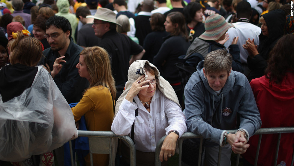Supporters try to stay dry in between rain showers while waiting for President Obama to speak at the University of Iowa on Friday. It was Obama's first day of campaigning after accepting the presidential nomination at the Democratic National Convention in Charlotte, North Carolina.