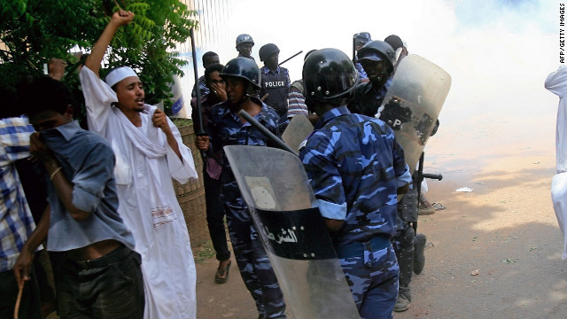 Sudanese policemen try to disperse protesters demonstrating against an amateur film mocking Islam outside the German embassy in Khartoum on September 14, 2012.