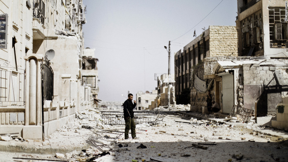 A Syrian rebel fighter patrols the Saif al-Dawla neighborhood on Wednesday.