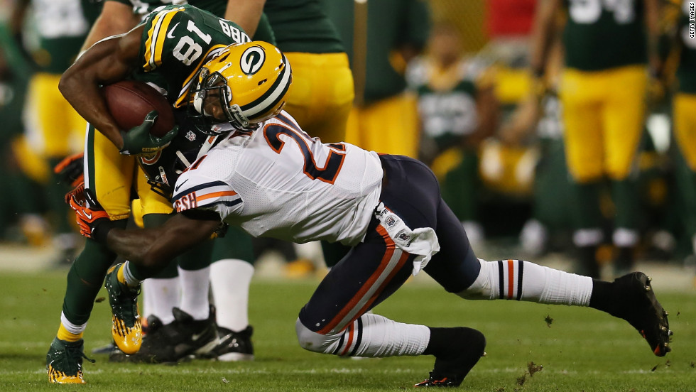Major Wright of the Chicago Bears tackles wide receiver Randall Cobb of the Green Bay Packers on Thursday.
