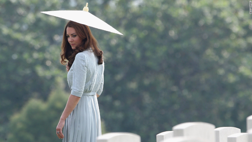 Catherine, Duchess of Cambridge, glances back at war graves as she leaves Kranji Commonwealth War Cemetery on the third day of her Diamond Jubilee Tour of the Far East with husband Prince William on Thursday, September 13 in Singapore.