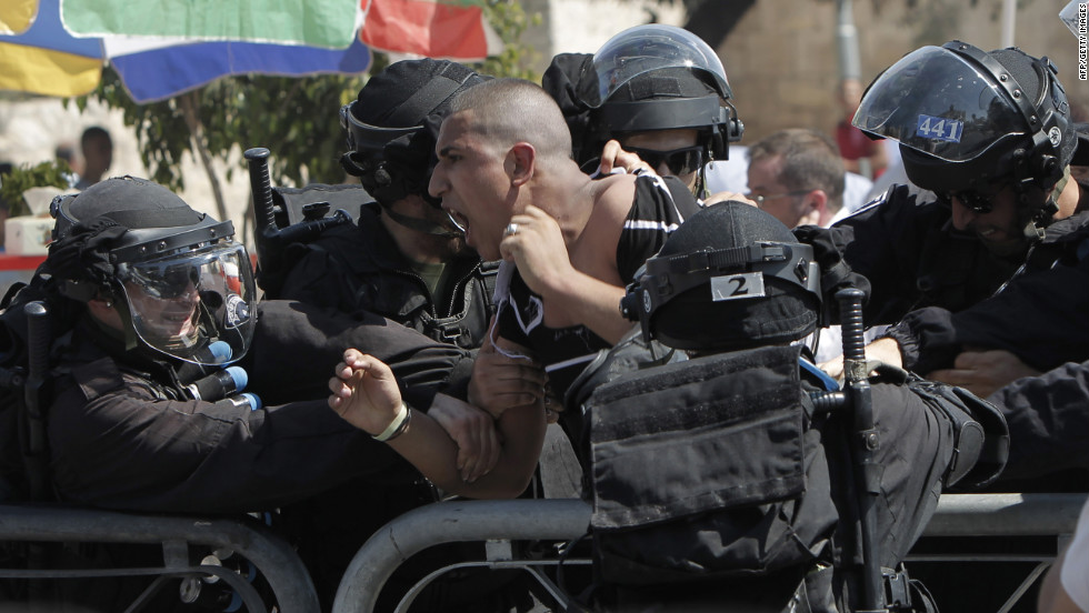 Israeli police arrest a Palestinian protester on Friday.