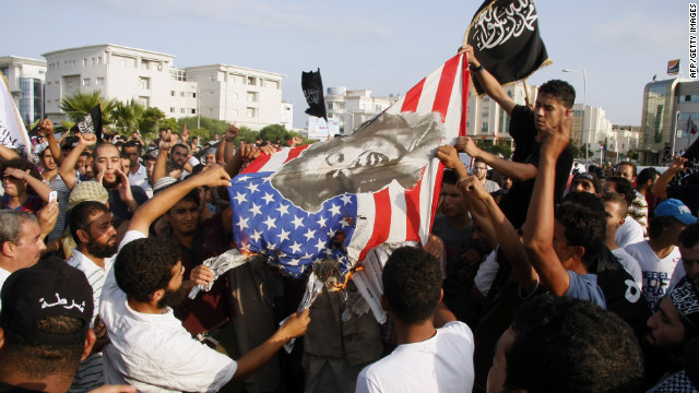 Tunisian protesters burn a US flag protesting against a film deemed offensive to Islam, outside the US embassy in Tunis on September 12, 2012.