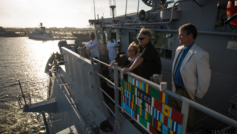 From left to right: June Hoffman, sister of the late Neil Armstrong and Armstrong's sons, Rick Armstrong, and Mark Armstrong look out from the USS Philippine Sea as it departs.