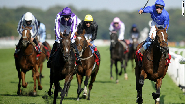 Encke, ridden by Mickael Barzalona (right), wins the St Leger Stakes ahead of Camelot (second left) at Doncaster Racecourse