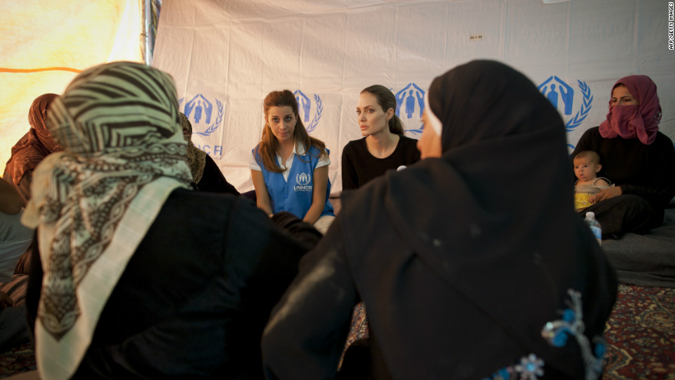 Jolie meets with refugees at the Za'atri refugee camp in Jordan to demonstrate solidarity with Syrian refugees and pay tribute to the Jordanian government for their refugee protection.