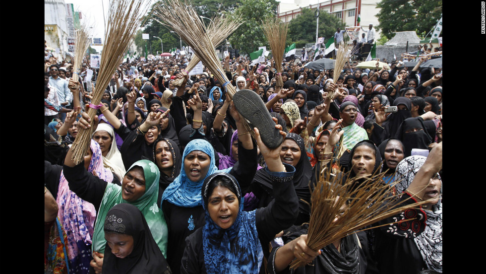 Muslim protesters holding shoes and brooms shout anti-U.S. slogans on Saturday during a protest against the film they consider blasphemous to Islam near the U.S. Consulate-General in Chennai, India.