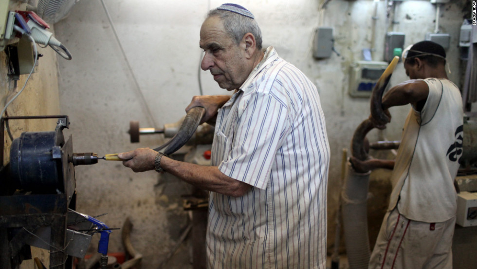 Avraham Ribak produces a shofar at his shofar factory in Tel Aviv on Friday.