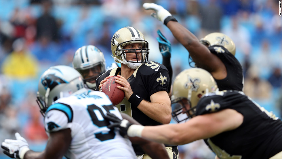 Quarterback Drew Brees of the New Orleans Saints looks to pass against the Carolina Panthers on Sunday.