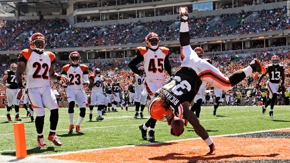 Trent Richardson of the Cleveland Browns flips into the end zone on Sunday at the end of a 32-yard touchdown run in the first half against the Cincinnati Bengals.
