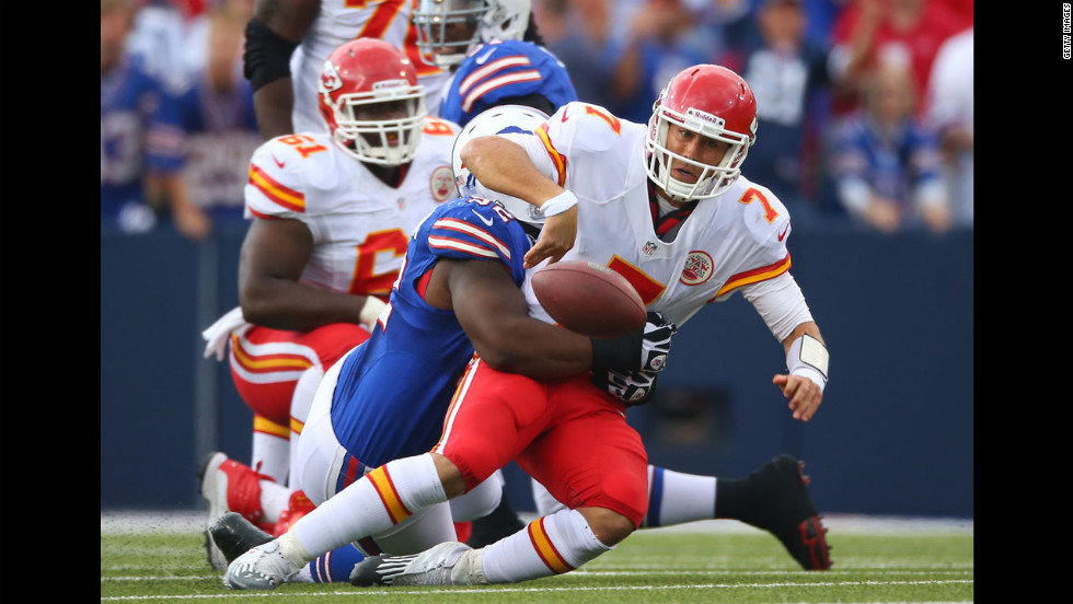 Quarterback Matt Cassel of the Kansas City Chiefs fumbles the ball after being tackled by Alex Carrington of the Buffalo Bills on Sunday.