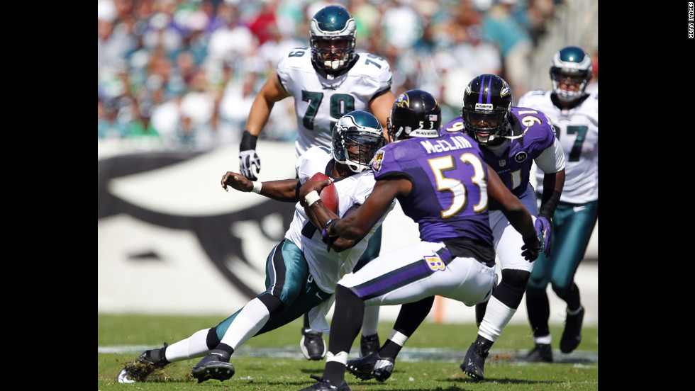 Quarterback Michael Vick of the Philadelphia Eagles runs for a six-yard gain against the Baltimore Ravens on Sunday at Lincoln Financial Field in Philadelphia.