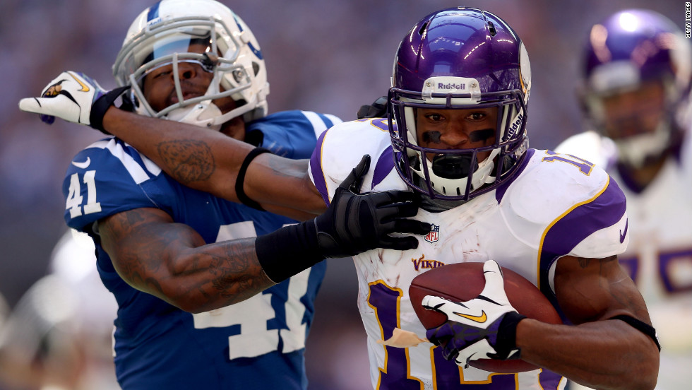 Wide receiver Percy Harvin of the Minnesota Vikings runs the ball while being defended by Antoine Bethea of the Indianapolis Colts on Sunday.