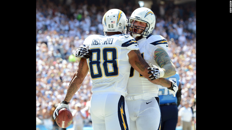 Nick Hardwick of the San Diego Chargers, right, reacts to Dante Rosario's touchdown Sunday against Tennessee Titans.