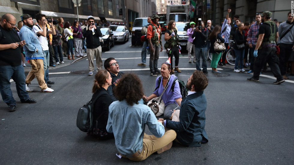 Protesters block a street near Wall Street during the one-year anniversary of the Occupy Wall Street movement on Monday.