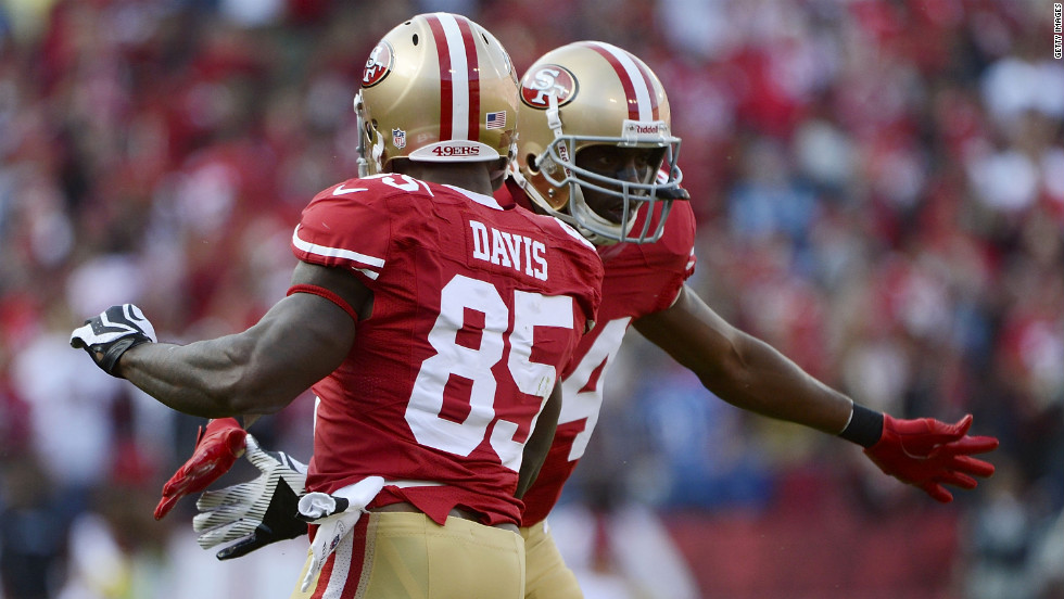 Vernon Davis and Randy Moss of the San Francisco 49ers celebrate Sunday after Davis caught a 21-yard touchdown pass against the Detroit Lions.