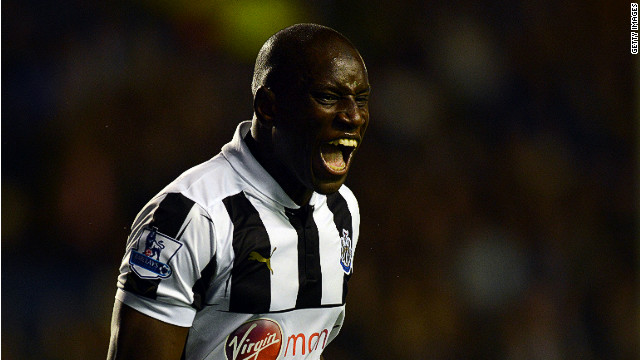 Demba Ba celebrates scoring his second equalizer against Everton at Goodison Park on Monday