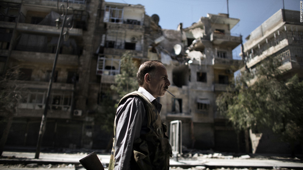 A Free Syrian Army fighter patrols a street near Aleppo's Old City on Sunday.