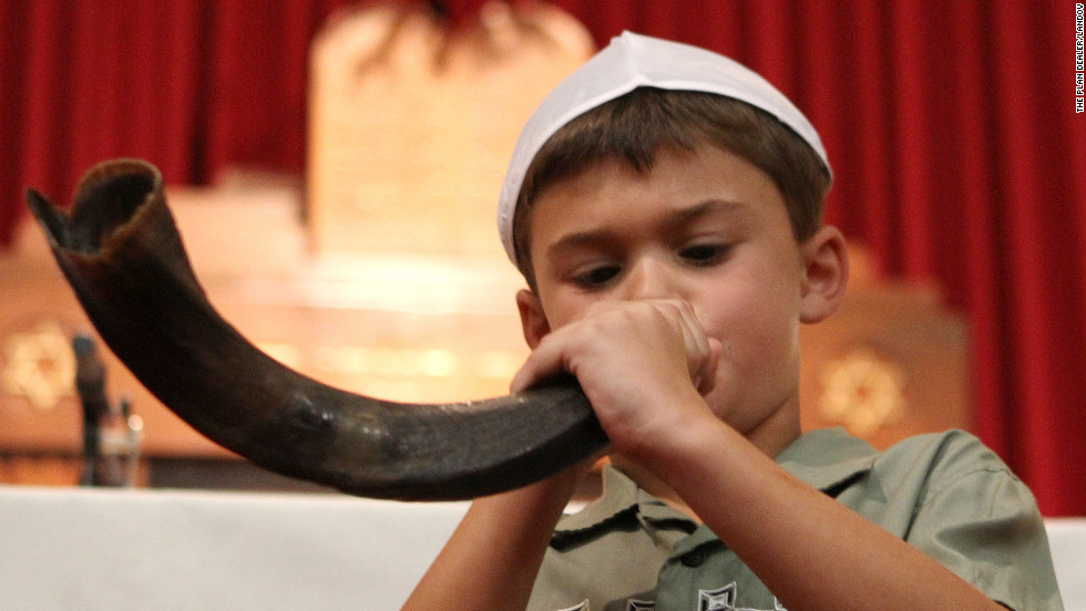 Randy Weiner, 8, sounds the shofar during services on the first night of Rosh Hashanah at Temple Beth Shalom in Hudson, Ohio, on Sunday, September 16. The shofar, or ram's horn, is sounded at the start of the Jewish holy days and will be sounded again at the close at Yom Kippur.