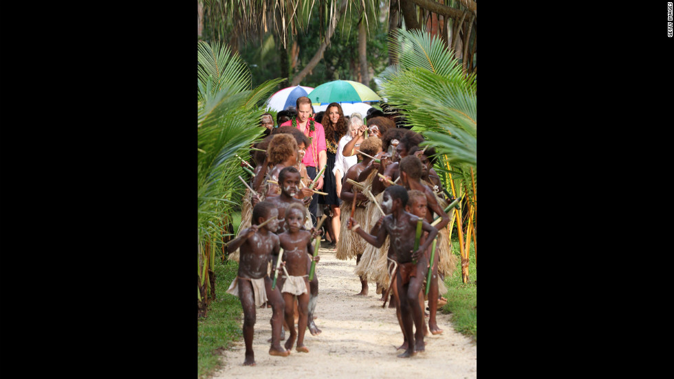 The Duke and Duchess of Cambridge are greeted by dancers as they visit Tuvanipupu Island in Honiara on Monday.