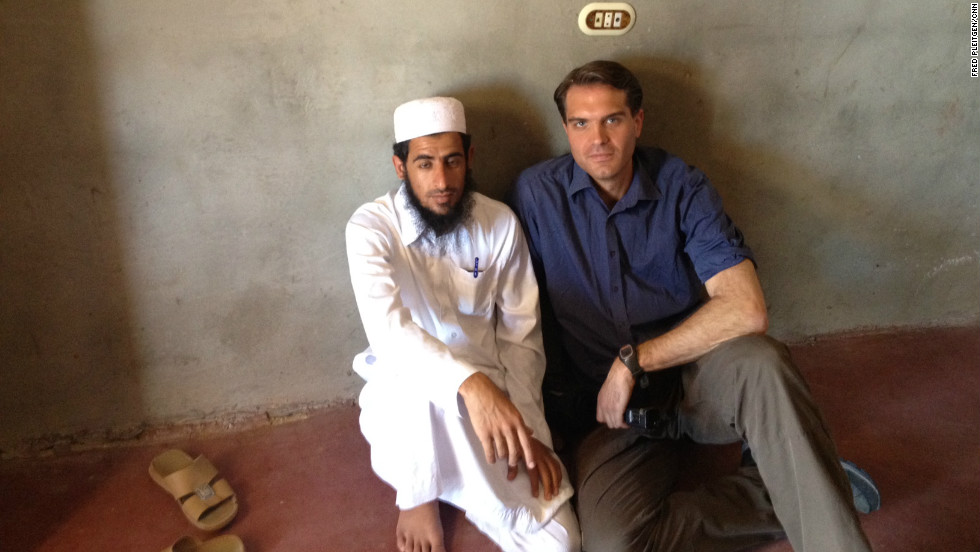 Sheikh Mohammed Abu Billal, who operates a safe house for captives who manage to escape the traffickers, sits with CNN's Fred Pleitgen.