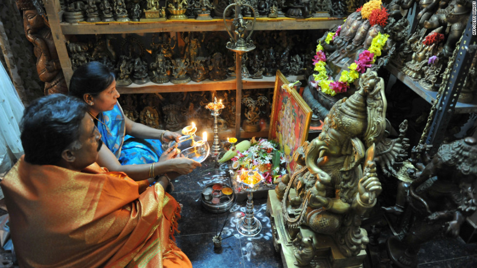 Collectors Pabsetti Shekhar and his wife Pabsetti Anuradha perform ritual prayers to idols of Ganesh, the elephant-headed Hindu lord, at their home in Hyderabad on Tuesday, September 18, the day before the  Ganesh Chaturthi Festival. Shekhar, 50, has a collection of 12,022 Ganesh idols. Hindu devotees bring home idols of Lord Ganesha in order to invoke his blessings for wisdom and prosperity ahead of the 11-day Ganesha Festival beginning Wednesday.