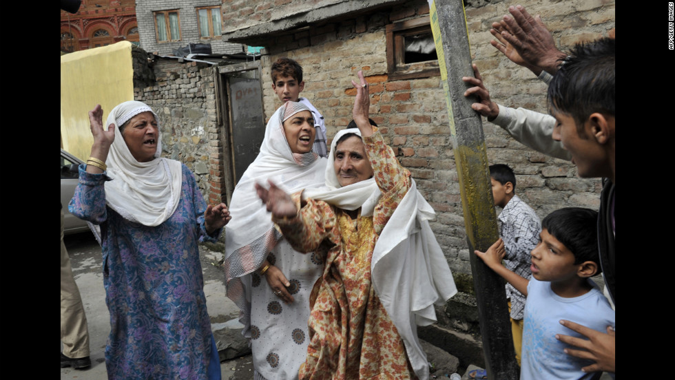 Muslim women shout Islamic slogans in Srinagar on Tuesday.