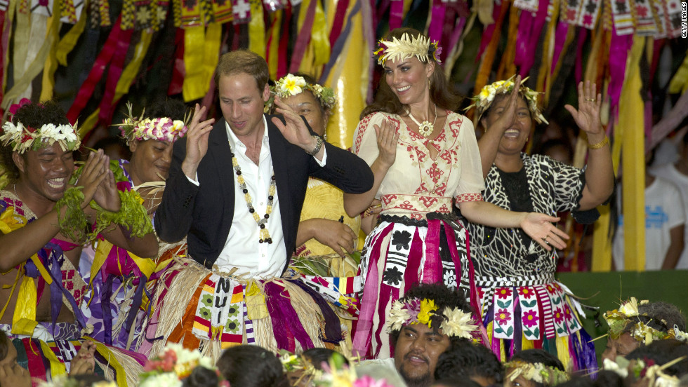 The duke and duchess dance with ladies at the Vaiku Falekaupule ceremony for an entertainment program on Tuesday in Tuvalu.