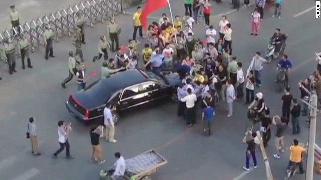 Protesters surround U.S. ambassador car