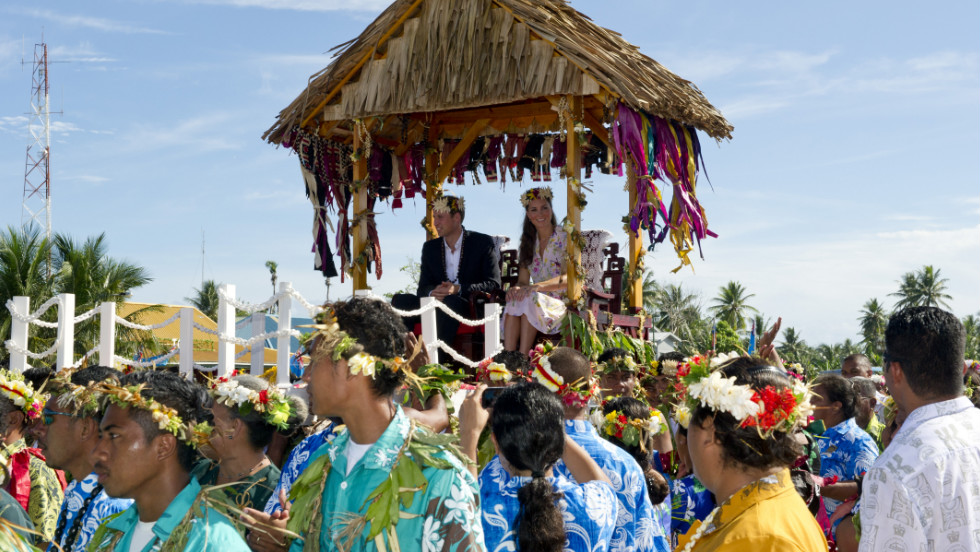 "Prince William and Catherine, Duchess of Cambridge, are carried as they bid farewell in Tuvalu on Wednesday, September 19. The Duke and Duchess of Cambridge -- on a tour marking the diamond jubilee of Queen Elizabeth II -- are visiting Singapore, Malaysia, the Solomon Islands and Tuvalu. <a href=""http://www.cnn.com/SPECIALS/world/photography/index.html"" target=""_blank"">See more of CNN's best photography</a>."