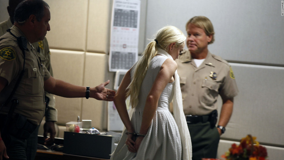 Lohan is led away in handcuffs at her probation progress report hearing in Los Angeles in October 2011.