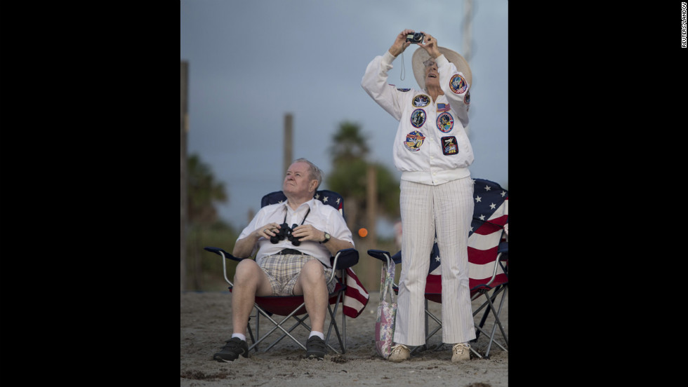 Jorgen and Ruth Sabinsky watch the flyover of Endeavour in Cocoa Beach, Florida, on Wednesday.