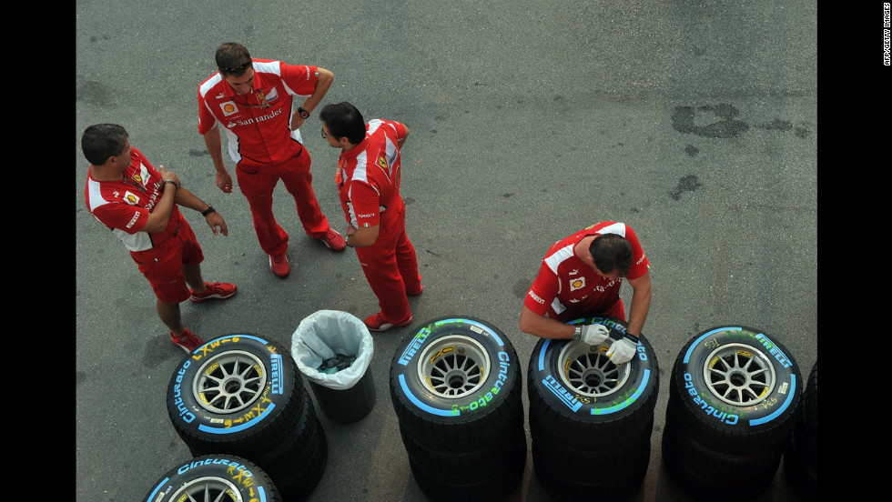 Ferrari engineers gather next to tires Wednesday, ahead of Formula One's Singapore Grand Prix, which takes place Friday through Sunday.
