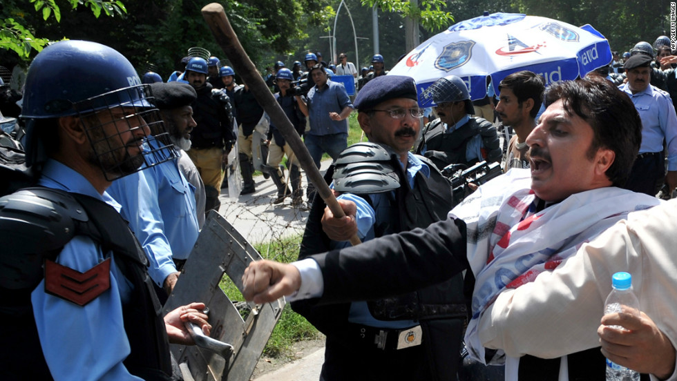 Pakistani riot policemen hold back lawyers shouting anti-U.S. slogans as they attempt to reach the U.S. Embassy  in Islamabad on Wednesday, September 19. More than 30 people have been killed around the world during more than a week of attacks and violent protests linked to a controversial film seen as insulting to the Prophet Mohammed.