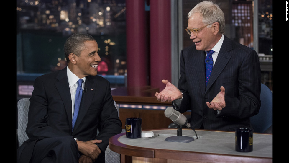"Obama and David Letterman speak during a break in the taping of the ""Late Show with David Letterman"" on Tuesday, September 18, at the Ed Sullivan Theater in New York."