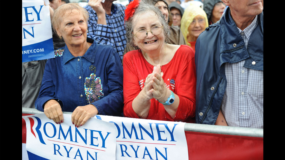 Supporters wait for Romney to speak at a campaign rally at Lake Erie College in Painesville, Ohio, on Friday.