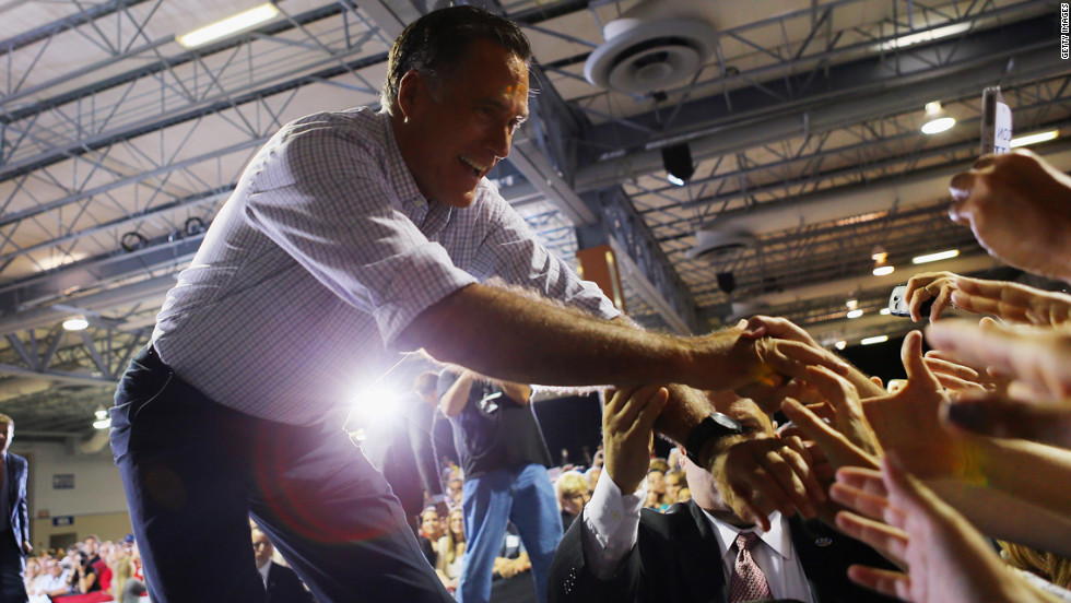 Republican presidential candidate Mitt Romney shakes hands with supporters during a Juntos Con Romney Rally at the Darwin Fuchs Pavilion on Wednesday, September 19, in Miami.