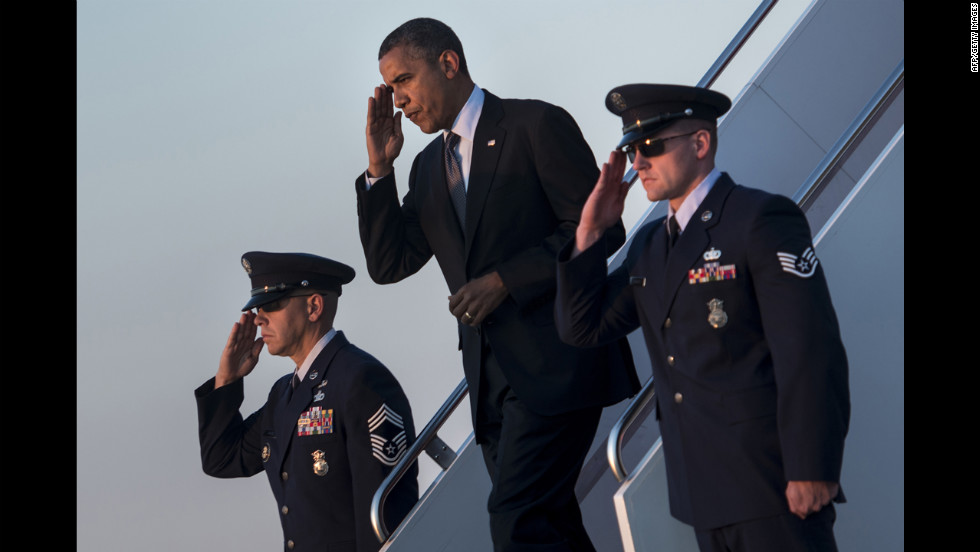 "President Barack Obama arrives at Andrews Air Force Base in Maryland on Thursday, September 13.  Obama returned to Washington after a two-day campaign trip with events in Nevada and Colorado. <a href=""http://www.cnn.com/SPECIALS/world/photography/index.html"" target=""_blank"">See more of CNN's best photography</a>."