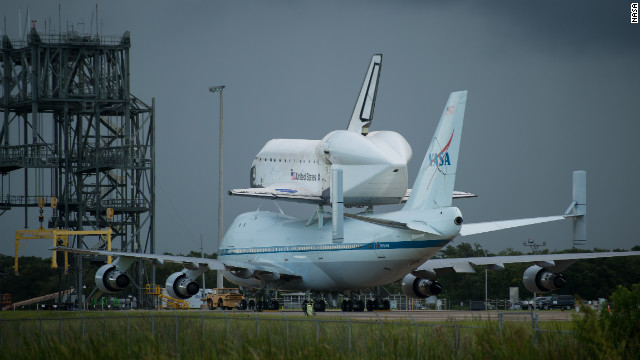 Space shuttle Endeavour is seen atop NASA's Shuttle Carrier Aircraft, or SCA, at the Shuttle Landing Facility at NASA's Kennedy Space Center on Monday, Sept. 17, 2012 in Cape Canaveral, Fla. The SCA, a modified 747 jetliner, will fly Endeavour to Los Angeles where it will be placed on public display at the California Science Center. This is the final ferry flight scheduled in the Space Shuttle Program era. Photo Credit: (NASA/Bill Ingalls)