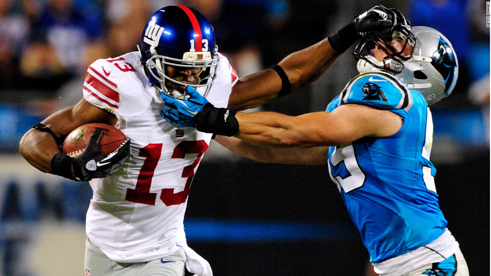 Ramses Barden of the New York Giants stiff-arms Luke Kuechly of the Carolina Panthers during a play on Thursday, September 20, at Bank of America Stadium in Charlotte, North Carolina.